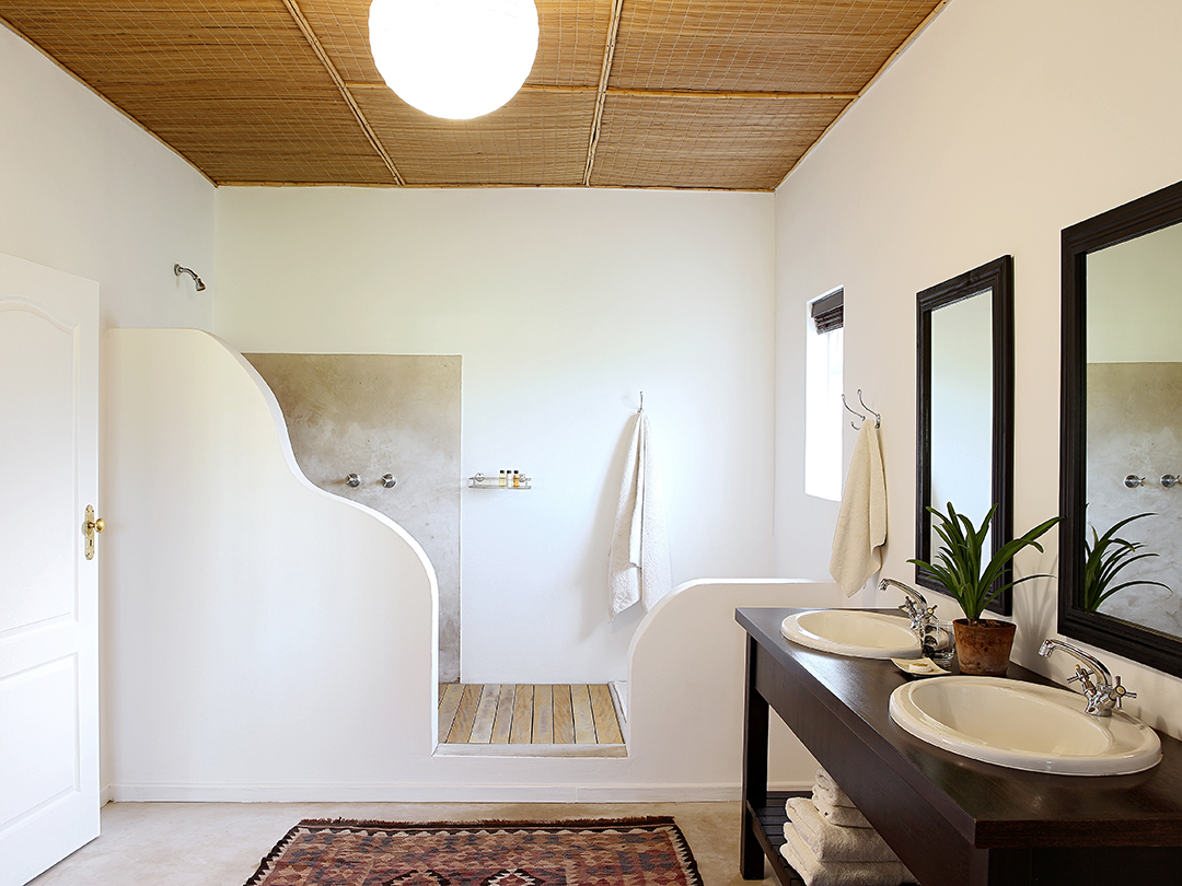 Soft, stylish bathroom in one of the Stable Cottages, photograph by Elsa Young.